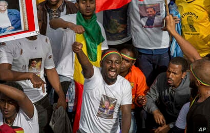 Ethiopians rally in solidarity with Prime Minister Abiy Ahmed, whose photo is seen on a participant's T-shirt, in Meskel Square in the capital, Addis Ababa, Ethiopia, June 23, 2018.