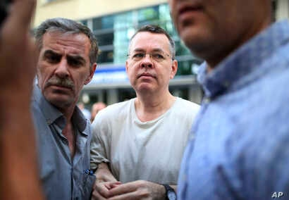 Andrew Craig Brunson, an evangelical pastor from Black Mountain, North Carolina, arrives at his house in Izmir, Turkey, Wednesday, July 25, 2018. (AP Photo/Emre Tazegul)