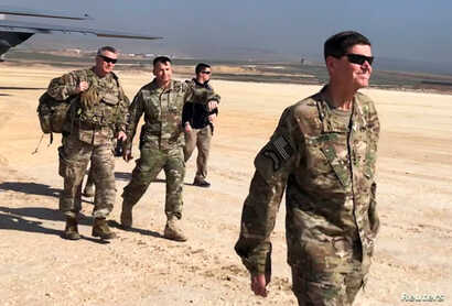 U.S. Army General Jospeh Votel, head of Central Command, visits an airbase at an undisclosed location in northeast Syria, Feb. 18, 2019.
