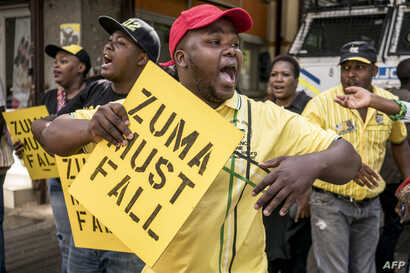 Supporters of the African National Congress Deputy President Cyril Ramaphosa hold placards and chant slogans during a demonstration to protest South African President and ANC member Jacob Zuma outside the ANC party headquarters in Johannesburg, Feb.