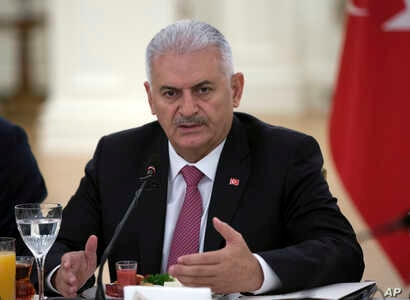 Turkish Prime Minister Binali Yildirim speaks during a meeting with representatives of German companies, in Ankara, Turkey, July 27, 2017.