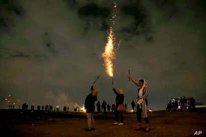 """Iranians light fireworks during a celebration, known as """"Chaharshanbe Souri,"""" or Wednesday Feast, marking the eve of the last Wednesday of the solar Persian year, March 19, 2019 in in Tehran."""