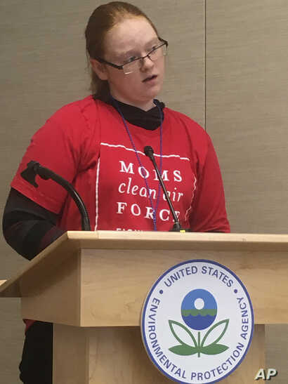 Alexis Elliott, 13, speaks at a U.S. EPA  hearing in Denver, Nov. 14, 2018, on methane. Elliott said emissions from oil and gas wells near her school are causing her serious health problems.