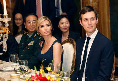 FILE - Ivanka Trump, second from right, the daughter and assistant to President Donald Trump, is seated with her husband, White House senior adviser Jared Kushner, right, during a dinner with President Donald Trump and Chinese President Xi Jinping at