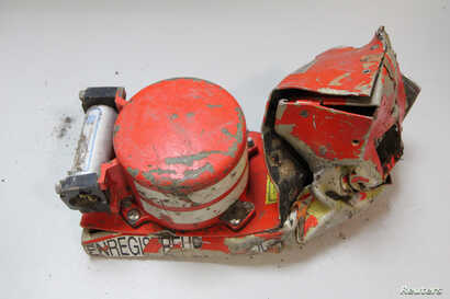 """A """"black box"""" voice recorder from the German Airbus operated by Lufthansa's Germanwings budget Airbus A320 crash is seen in this photo released by the BEA, France's air accident investigative agency, March 25, 2015."""