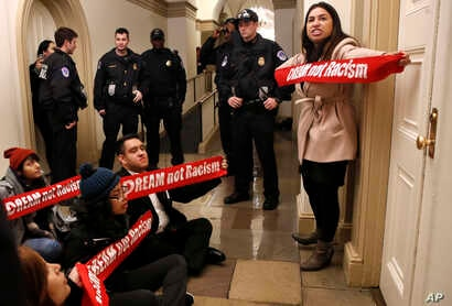 "Diana Colin, right, with the Coalition for Humane Immigrant Rights, shouts, ""McCarthy you have no heart,"" as the group from California protests outside the office of House Majority Leader Kevin McCarthy, Jan. 18, 2018, on Capitol Hill in Washington, ..."