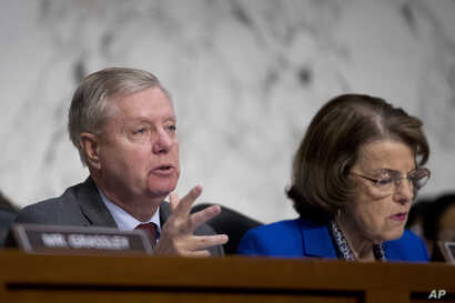 Senate Judiciary Committee Chairman Lindsey Graham, flanked by Ranking Member Sen. Dianne Feinstein questions Attorney General nominee William Barr during a Senate Judiciary Committee hearing on Capitol Hill in Washington, Jan. 15, 2019.