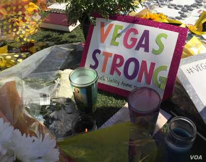 Sign seen at makeshift memorial for victims of mass shooting in Las Vegas on Sunday, Oct. 2 that killed 58 people. (Photo: C. Presutti / VOA)