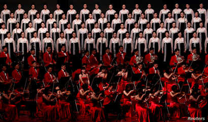 Performers sing during a concert on the eve of 70th anniversary of North Korea's founding in Pyongyang, Sept. 8, 2018.