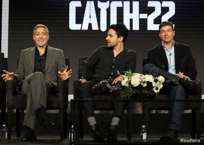 "Actor, executive producer, and director George Clooney (L-R), actor Christopher Abbott, and actor Kyle Chandler speak on a panel for the Hulu series ""Catch-22"", during the Television Critics Association (TCA) Winter Press Tour in Pasadena, California..."