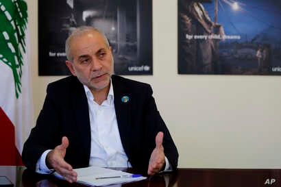 Lebanese Minister of State for Refugee Affairs, Mouin Merhebi, speaks during an interview with the Associated Press, at his office, in Beirut, Lebanon, Nov. 27, 2018.