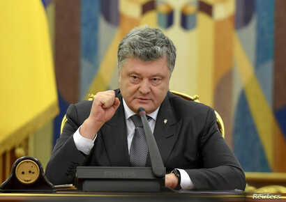 FILE - Ukrainian President Petro Poroshenko speaks during a meeting of the country's Security and Defence Council in Kyiv, May 2, 2018. (Ukrainian Presidential Press Service)