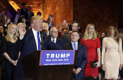 Surrounded by family and supporters, Republican presidential candidate Donald Trump speaks during a New York state primary campaign event in New York City, April 19, 2016.