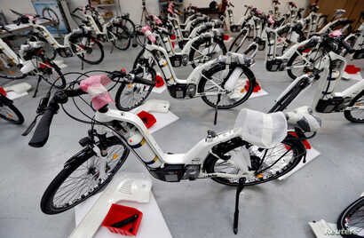 Alpha bikes, first industrialized bicycle to use a hydrogen fuel cell, are displayed at the Pragma Industries factory in Biarritz, France, Jan. 15, 2018.