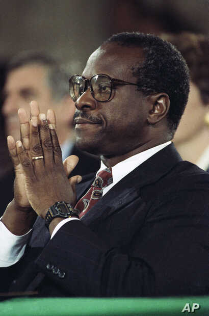 FILE - Judge Clarence Thomas pauses during testimony before the Senate Judiciary Committee on Capitol Hill in Washington, Oct. 11, 1991. A calm and resolute Thomas categorically denied Anita Hill's accusations of sexual harassment and told a tense se...
