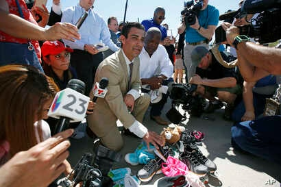 Miami Mayor Francis Suarez, left, and Columbia, South Carolina Mayor Steve Benjamin explain to the media the symbolic gesture of bringing shoes as gifts for immigrant children that are being held at a facility in Tornillo, Texas, June 21, 2018.