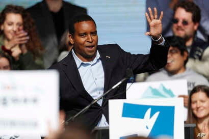FILE - Joe Neguse, Democratic candidate for U.S. House District 2 in Colorado, greets voters before U.S. Senator Bernie Sanders speaks during a rally with young voters on the campus of the University of Colorado, Oct. 24, 2018, in Boulder, Colo.