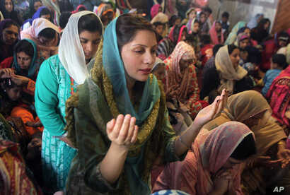 Christian women pray during an Easter service at St Anthony's Church in Lahore, Pakistan, March 27, 2016.