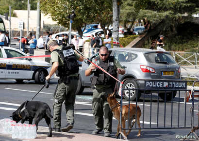 Israeli police secure the area following a shooting incident that an Israeli police spokesperson described as a terrorist attack, near police headquarters in Jerusalem, Oct. 9, 2016.