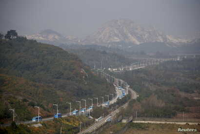 Buses transporting South Korean participants for a reunion travel on the road leading to North Korea's Mount Kumgang resort, in the demilitarized zone (DMZ) separating the two Koreas, just south of the DMZ in Goseong, South Korea, Oct. 20, 2015.