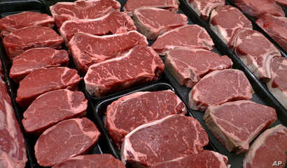 This Jan. 18, 2010 file photo shows steaks and other beef products displayed for sale at a grocery store in McLean, Va.