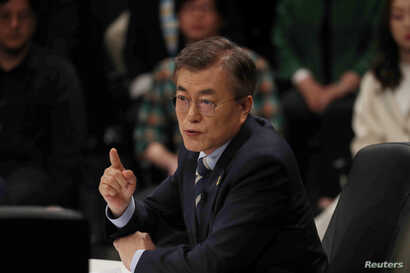 Moon Jae-in, the presidential candidate of the Democratic Party of Korea, speaks during a televised debate in Goyang, South Korea, April 25, 2017.
