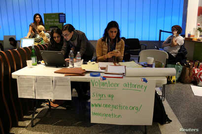 Volunteer immigration attorneys organize to help as people gather to protest against President Donald Trump's executive order travel ban at Los Angeles International Airport, Jan. 31, 2017.