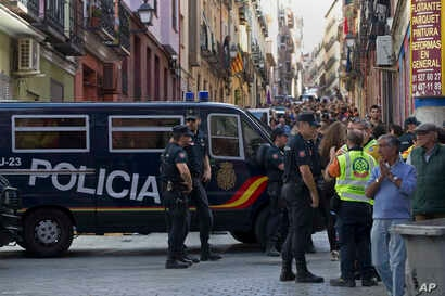 Police patrol at an event to support the Catalonia independence referendum in Madrid, Spain, Sept. 17, 2017.