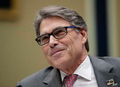 FILE - In this Oct. 12, 2017, file photo,Energy Secretary Rick Perry listens during a hearing about the electrical grid, on Capitol Hill in Washington. The Federal Energy Regulatory Commission on Jan. 8, 2018, rejected a Trump administration plan to ...
