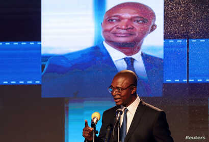 FILE - Emmanuel Ramazani Shadary, Congolese Presidential candidate for the ruling Common Front of Congo (FCC) coalition announces his political manifesto in Kinshasa, Democratic Republic of Congo Nov. 19, 2018.