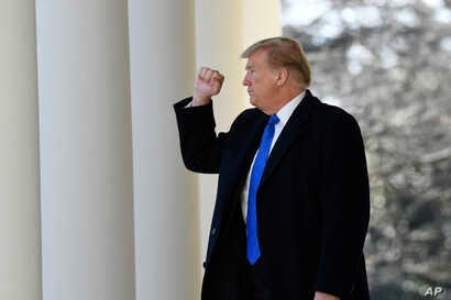 President Donald Trump turns back to the audience after speaking during an event in the Rose Garden at the White House in Washington, Feb. 15, 2019, to declare a national emergency in order to build a wall along the southern border.