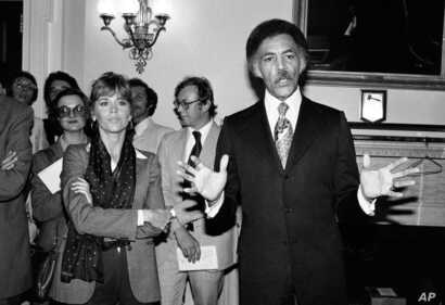 FILE - In this Sept. 26, 1979 file photo, Jane Fonda stands beside, Rep. Ronald Dellums, D-Calif., right, in Washington. Dellums, a fiery anti-war activist who championed social justice as Northern California's first black congressman.