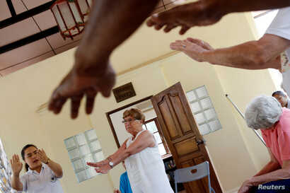 A group of retired foreigners attend a Tai Chi class, while staying at the Care Resort in Chiang Mai, Thailand April 6, 2018.