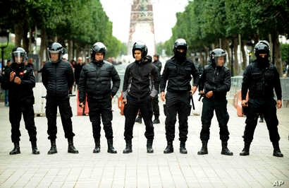 Tunisian riot police officers line up during a protest against the 2018 budget in Tunis, Jan. 9, 2018.