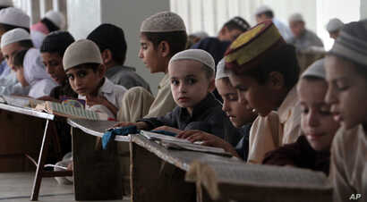 Pakistani children attend lessons at a madrassa, or a religious school, to learn Quran, in Karachi, Pakistan, Sept. 2, 2015.