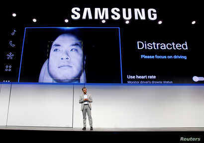 Arvin Baalu, vice president of product management at Harman International, talks about the Samsung Digital Cockpit during a Samsung news conference at the 2019 CES in Las Vegas, Jan. 7, 2019.