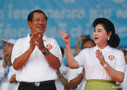 Cambodia's Prime Minister and president of the ruling Cambodian People's Party Hun Sen and his wife Bun Rany attend an election campaign in Phnom Penh, Cambodia, July 7, 2018.