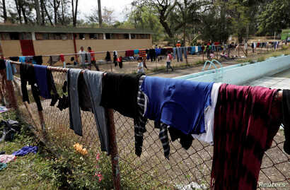 Central American migrants' clothes dry on a fence, as the migrants take a break from traveling in their caravan on their journey to the U.S., in Matias Romero, Oaxaca, Mexico, April 3, 2018.