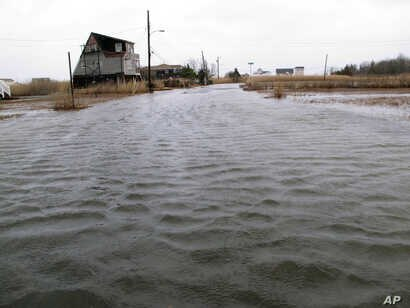 FILE - This March 14, 2017, photo shows the flooded streets of a back bay neighborhood in Manahawkin, N.J., after a moderate storm.