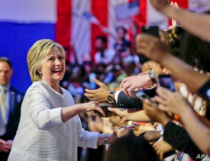 Democratic presidential candidate Hillary Clinton greets supporters during a rally on June 7, 2016. (AP)