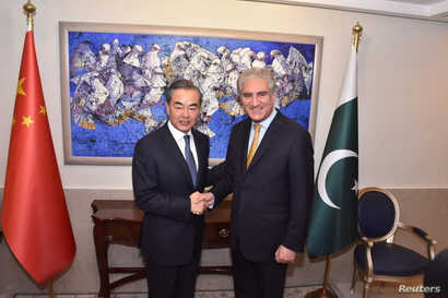 Pakistan's Foreign Minister Shah Mehmood Qureshi shakes hand with Chinese State Councilor and Foreign Minister Wang Yi at the Ministry of Foreign Affairs in Islamabad, Pakistan, Sept. 8, 2018. (Ministry of Foreign Affairs handout via Reuters).