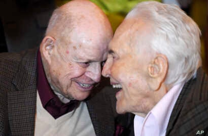 Comedian Don Rickles (left) laughs with actor Kirk Douglas at Douglas' 100th birthday party at the Beverly Hills Hotel, Dec. 9. 2016, in Beverly Hills, Calif.