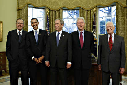 President-elect Barack Obama is welcomed by President George W. Bush for a meeting at the White House in Washington, Wednesday, Jan. 7, 2009, with former presidents, from left, George H.W. Bush, Bill  Clinton, and Jimmy Carter.