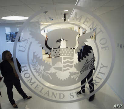 FILE - The Department of Homeland Security logo is seen at one of its annex facilities in Fairfax, Virginia, July 22, 2015.