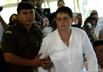 FILE - Australian Renae Lawrence is removed from a Denpasar court after she was given a life sentence for drug trafficking on the Indonesian resort island of Bali, Feb. 13, 2006.