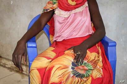 In this photo taken Dec. 7, 2018, an 18-year-old woman recounts the day in early November when she and a friend were bound, dragged into the bush and raped by four men with guns, as she sits in a hospital in Nhialdu, South Sudan.