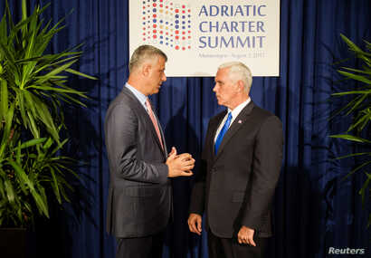 FILE - U.S. Vice President Mike Pence and Kosovo's President Hashim Thaci speak during a photo opportunity at the Adriatic Charter Summit in Podgorica, Montenegro, Aug. 2, 2017.