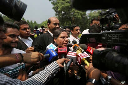 FILE - Farha Faiz, a Supreme Court lawyer, speaks after the court declared a Muslim practice that allows men to instantly divorce their wives unconstitutional in New Delhi, Aug. 22, 2017.