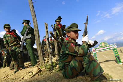 A TNLA (Ta'ang National Liberation Army) soldier looks on, during the 51st anniversary of the Ta'ang National Resistance Day at Homain, Nansan township in the northern Shan state, Jan. 12, 2014.