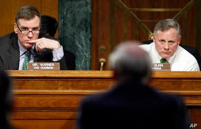 Senate Intelligence Committee Chairman Richard Burr, R-N.C., right, and Committee Vice chairman Mark Warner, D-Va., left, listen on Capitol Hill in Washington, Feb. 28, 2017, as Director of National Intelligence-designate Dan Coats testifies at his c...